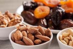 Nuts in ceramic bowls with dried fruits Royalty Free Stock Image