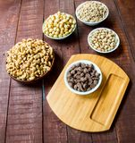 Nuts and chocolate covered peanuts royalty free stock photo
