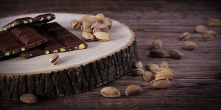 Nuts and Chocolate. Ripe Nuts and Chocolate Concept and Decoration royalty free stock image