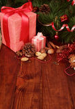 Nuts, chocolate and two Christmas gift stock photo