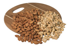 Nuts on a chopping board Royalty Free Stock Image