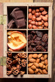 Nuts, cinnamon, raisins and dry fruits as an ingredient for dess Stock Photography