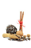 Nuts, cinnamon sticks and some cloves. On white Royalty Free Stock Images