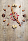 Nuts, cinnamon sticks and star anise Stock Photos