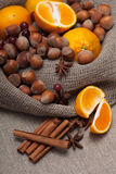 Nuts and citrus. On a tablecloth Stock Photo