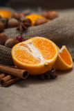 Nuts and citrus. On a tablecloth Royalty Free Stock Photo