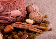 Nuts and clay pot Stock Photos