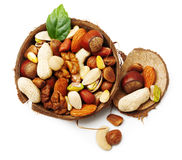 Nuts in cracked coconut isolated royalty free stock photography