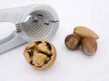 Nuts and cracker. A selection of nuts and a nut cracker Stock Image
