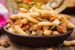 Nuts and crackers to beer Royalty Free Stock Photo