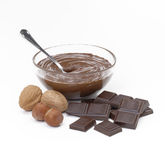 Nuts cream,chocolate sticks and nuts. Chocolate nuts cream bowl and chocolate sticks. Nuts cream,chocolate sticks and nuts Stock Image