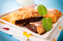 Nuts cream in pastry. Sweet nuts cream in the fried pastry.Selective focus in the middle of pastry Royalty Free Stock Photos
