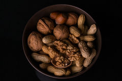 Nuts. Different types of nuts are in a plate royalty free stock photo