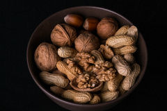 Nuts. Different types of nuts are in a plate stock photo