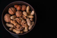 Nuts. Different types of nuts are in a plate royalty free stock image