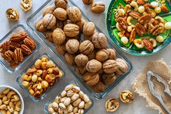 Nuts, different types. On the stone table stock images