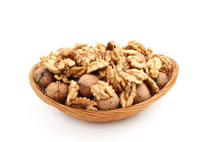 Nuts in dish isolated on white Stock Photography