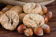 Nuts and dried figs. Closeup on a little sack with nuts and dried figs Stock Photography