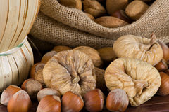 Nuts and dried figs. Closeup on a little sack with nuts and dried figs Royalty Free Stock Photo