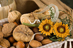 Nuts and dried figs. Little basket with dried figs and nuts, over wooden table Royalty Free Stock Images