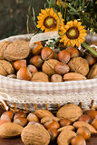 Nuts and dried figs. Little basket with dried figs and nuts, over wooden table Stock Photography