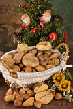 Nuts and dried figs (at Christmas). Little basket with dried figs and nuts, over wooden table Stock Photography