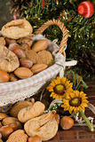 Nuts and dried figs (at Christmas). Little basket with dried figs and nuts, over wooden table Stock Photo