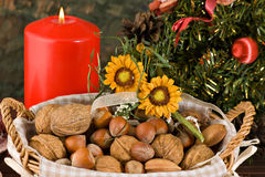 Nuts and dried figs (at Christmas). Little basket with dried figs and nuts, over wooden table Royalty Free Stock Image