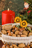 Nuts and dried figs (at Christmas). Little basket with dried figs and nuts, over wooden table Stock Images