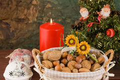Nuts and dried figs (at Christmas). Little basket with dried figs and nuts, over wooden table Stock Photos