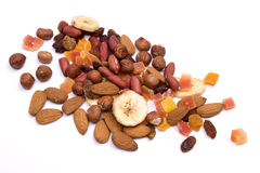 Nuts and dried fruit. Isolated on white background Royalty Free Stock Image