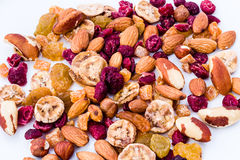 Nuts and Dried Fruit Mix. Closeup of a mix of nuts and dried fruit on a white background Stock Photography