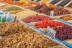 Nuts and dried fruits - the best organic food, city market, Baikonur, Kazakhstan. Walnuts close-up against the background of other nuts and dried fruits stock photos