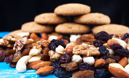Nuts, dried fruits and biscuits Stock Images