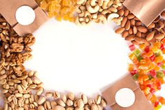 Nuts and dried fruits in the craft package. Photo for the catalog. Place for logo, your text. royalty free stock image