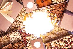 Nuts and dried fruits in the craft package. Photo for the catalog. Place for logo, your text. royalty free stock photo