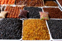 Nuts and dried fruits, on the market counter. stock photography