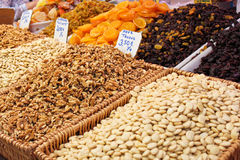 Nuts and dried fruits on the market Royalty Free Stock Photos