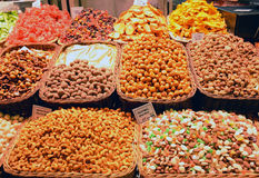 Nuts and dried fruits on the market, sweets on the counter Royalty Free Stock Images