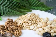 Nuts and dried fruits. Mix on the plate Stock Photo