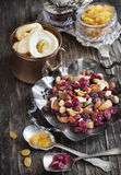 Nuts and dried fruits mix. On wooden table royalty free stock photo