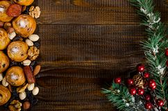 Nuts, dried fruits, pistachios and homemade cookies scattered from the bag on the table, New Year attributes, with a place for wri stock image