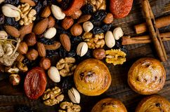 Nuts, dried fruits, pistachios and homemade cookies are scattered from the bag on the table royalty free stock image