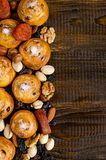 Nuts, dried fruits, pistachios and homemade cookies scattered from the bag on the table with a place for writing royalty free stock image