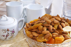 Nuts and dried fruits. Tea set Royalty Free Stock Photography