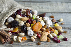 Nuts and dried fruits on vintage wooden boards Royalty Free Stock Photos