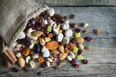 Nuts and dried fruits on vintage wooden boards royalty free stock photo