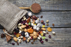 Nuts and dried fruits on vintage wooden boards Royalty Free Stock Images