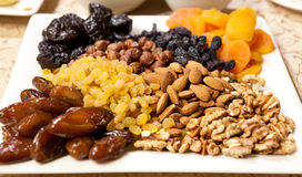 Nuts and dried fruits. Walnuts, almonds, hazelnuts and various dried fruit Stock Photo