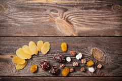 Nuts and dried fruits  on wooden background Royalty Free Stock Images